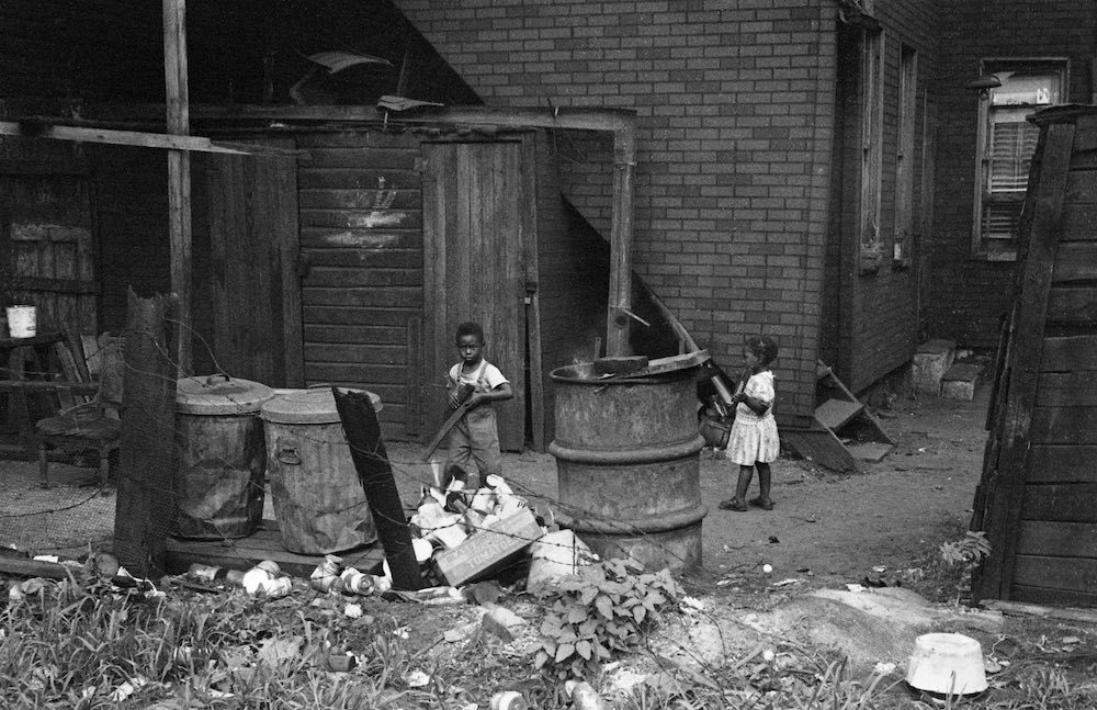 Children Playing Behind Building