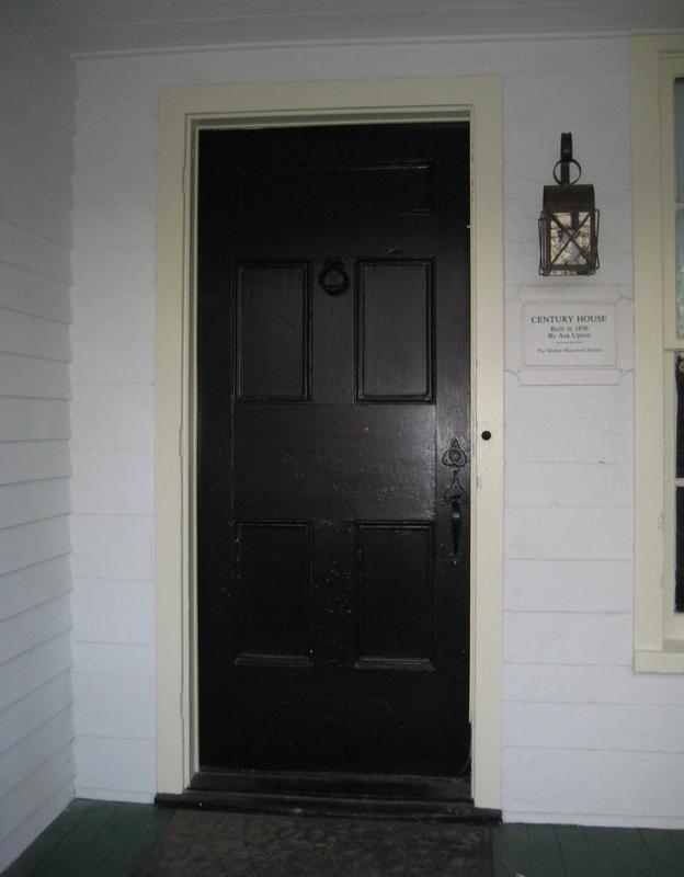 Front door and century home plaque.