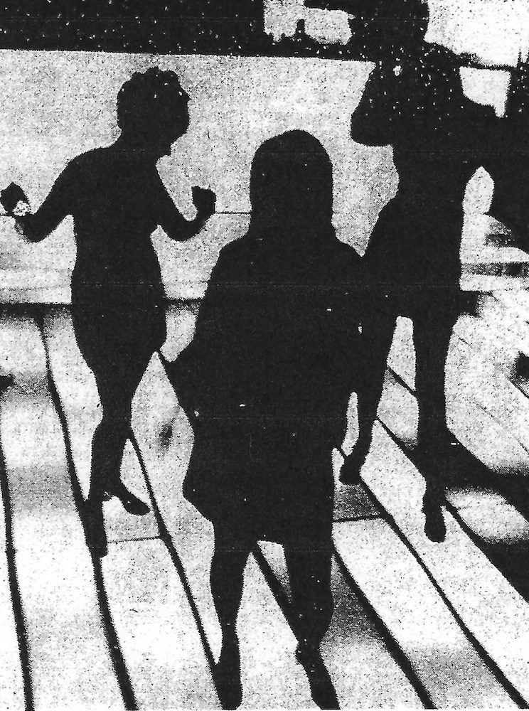 Dancers silhouetted on the Mad Hatter's flashing stage, 1971.
